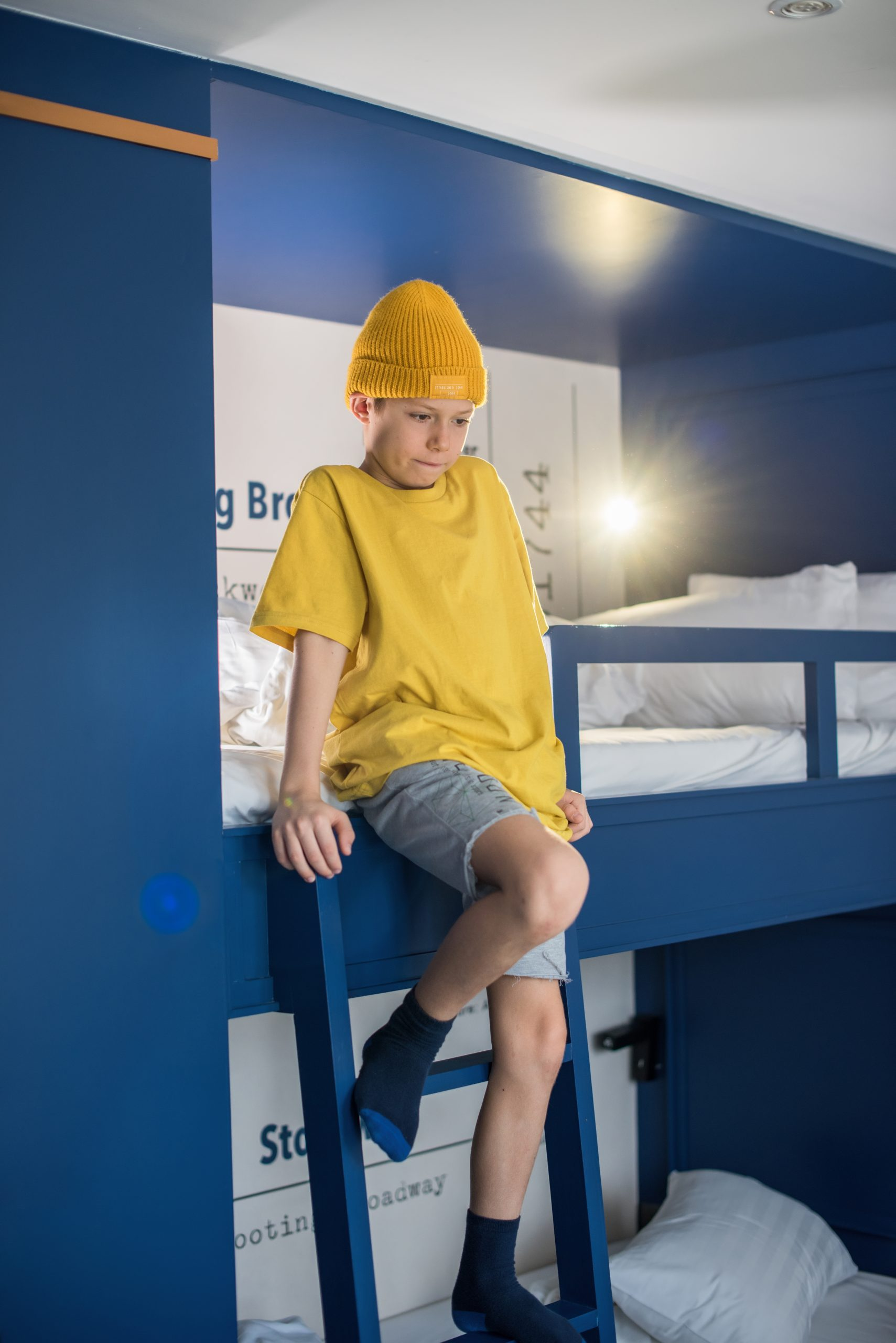 boy-in-yellow-t-shirt-and-hat-is-spending-time-pla-D56YL5H